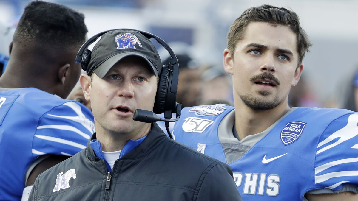 In this Dec. 7, 2019 photo, Memphis deputy head coach Ryan Silverfield, left, watches a replay...