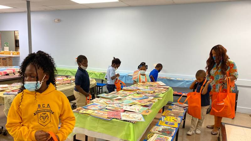 Students at Binghampton Christian Academy choose books for at-home library during book fair