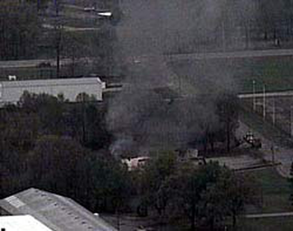 An aerial view from Chopper 5 shows smoke rising from a building destroyed by the fire.
