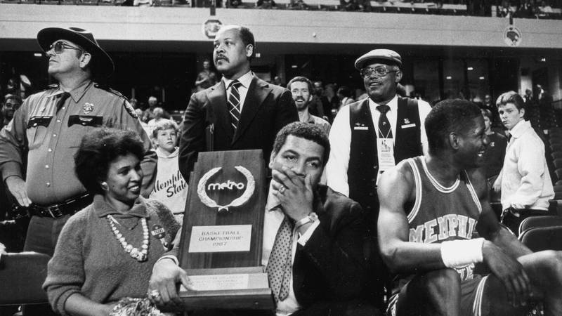 Coach Larry Finch with Metro Conference Tournament trophy after the Tigers' 75-52 victory over...