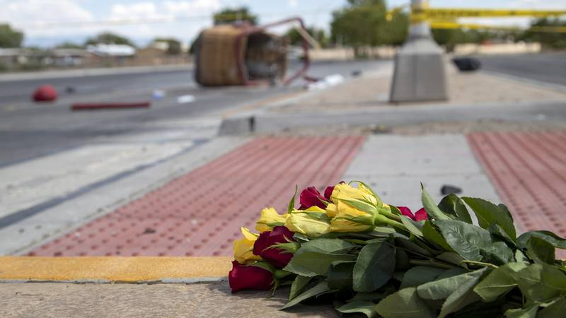 FILE - In this June 26, 2021 file photo, a bouquet of flowers from a mourner is placed near the...