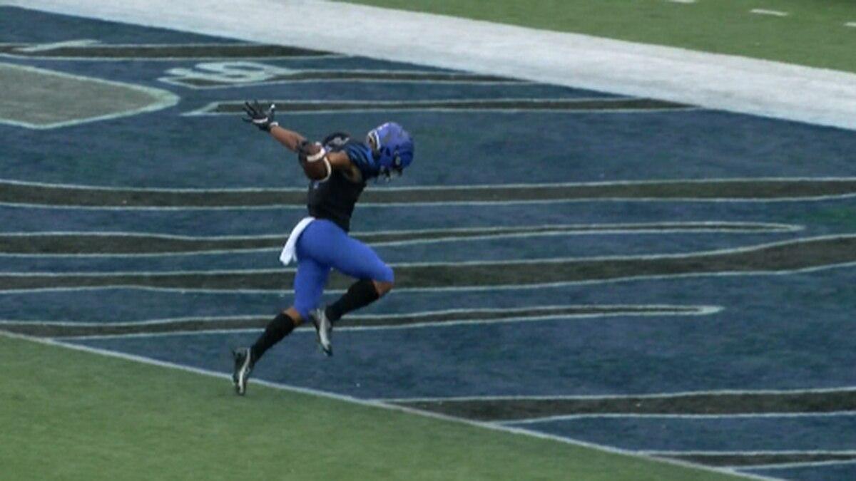Austin leans past the goal line on a 64-yard punt return for TD