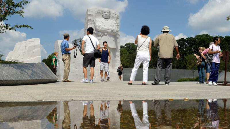 FILE - Visitors are shown at The Martin Luther King, Jr., Memorial in Washington, Tuesday, Aug....