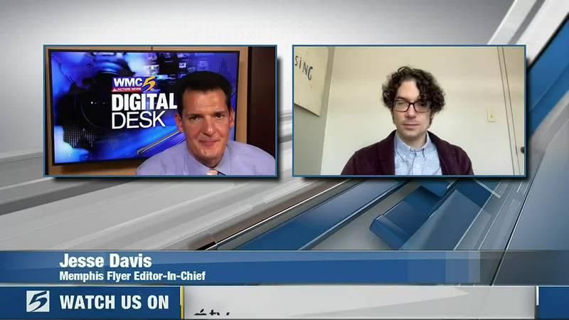 Memphis Flyer Editor-in-Chief Jesse Davis talks with Andrew Douglas at the digital desk