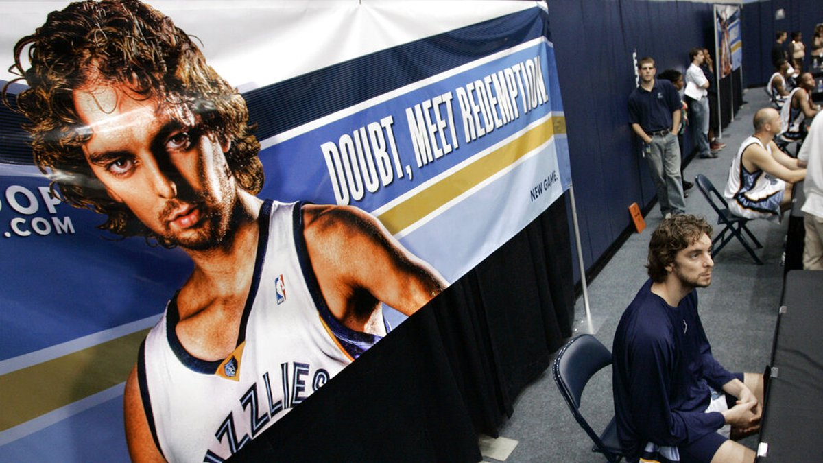 ** FILE ** Memphis Grizzlies forward Pau Gasol, of Spain, sits in front a poster of himself as...