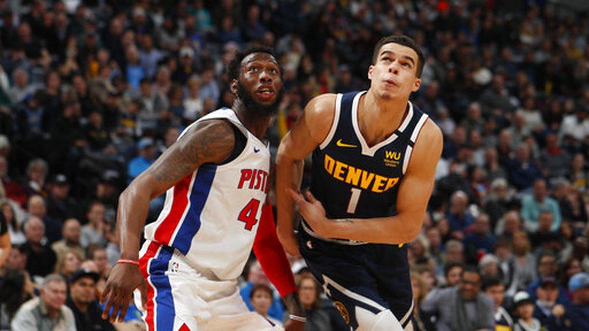 Detroit Pistons center Donta Hall, left, jostles for position with Denver Nuggets forward...