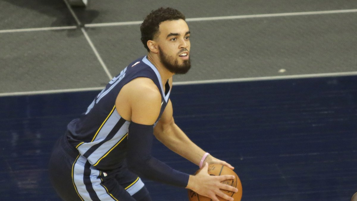 Memphis Grizzlies guard Tyus Jones passes against the Minnesota Timberwolves during an NBA...