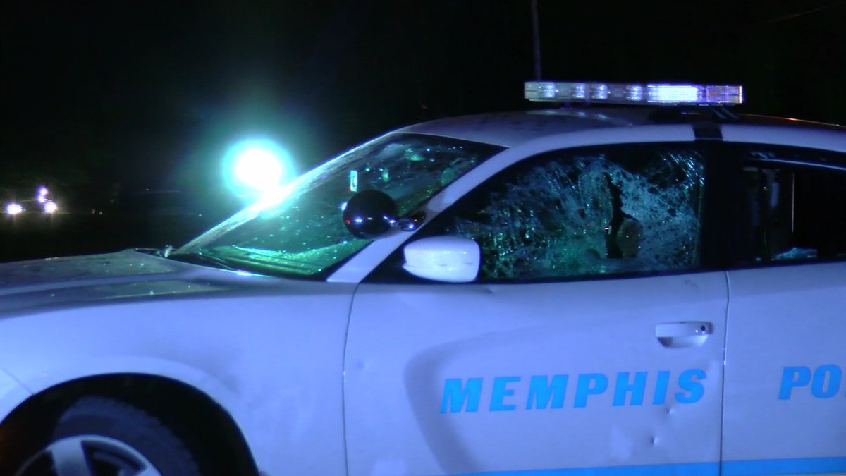 A police cruiser had a smashed window amid the protests.