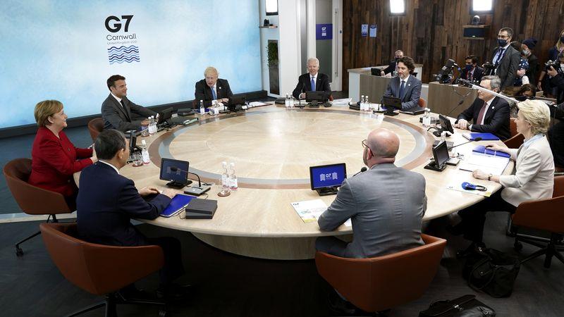 Clockwise from left, German Chancellor Angela Merkel and French President Emmanuel Macron,...