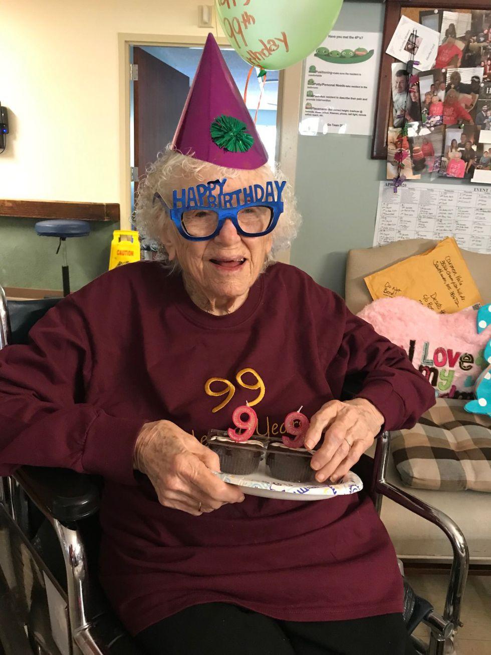 Family visits, celebrates grandmother's 99th birthday through window