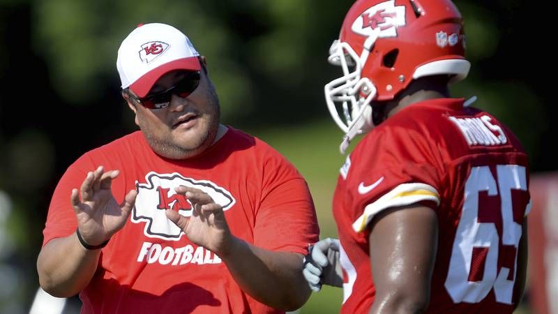 FILE - Then-Kansas City Chiefs assistant offensive line coach Eugene Chung, left, talks with...