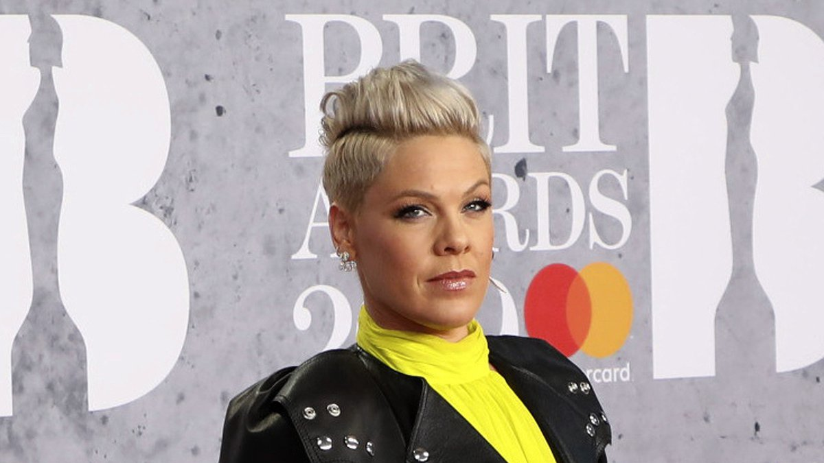 FILE - In Wednesday, Feb. 20, 2019 file photo, singer Pink poses for photographers upon arrival...