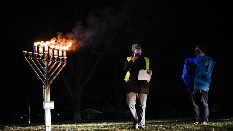 Rabbi Shloime Greene speaks to attendeesduring the sixth day of Hanukkah, Tuesday, Dec. 15,...