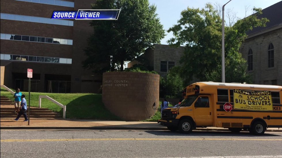 A curious recruitment drive outside of the Shelby County Criminal Justice Center demand some...