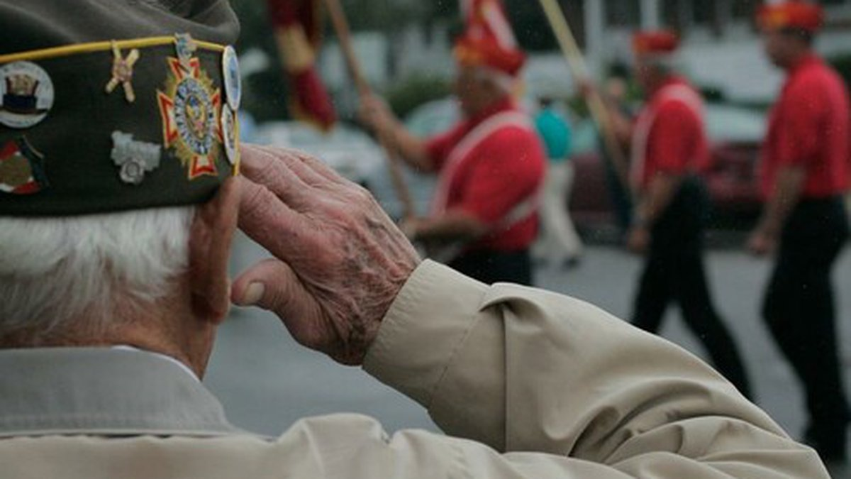 Joeseph Kovac, a retired sailor and Veterans of Foreign Wars past commander, salutes one of...