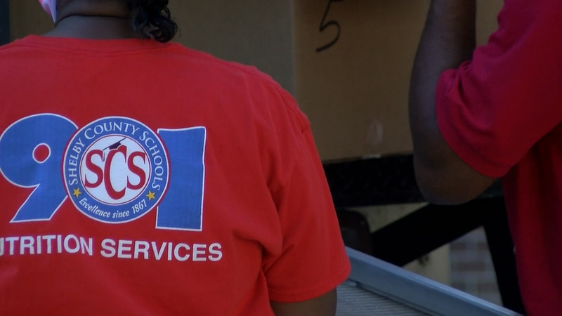 SCS Nutrition Services employees hands out boxes of food at meal distribution event at Central...