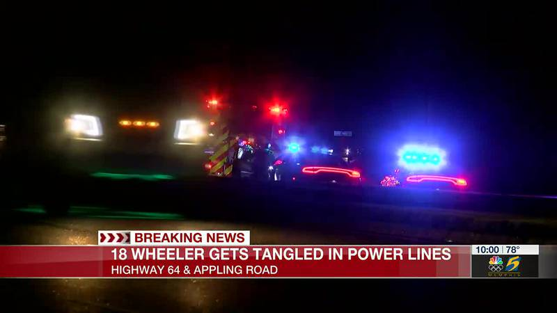 18-wheeler hits utility pole at Bartlett intersection, leaving live wires in roadway