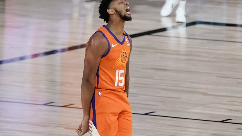 Phoenix Suns guard Cameron Payne (15) reacts after hitting a three point shot against the...