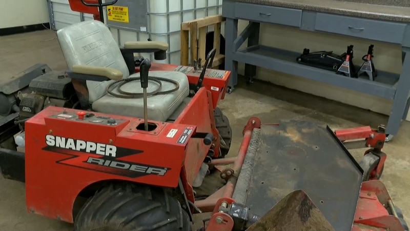 Lawn mower in the Shelby County Office of Reenetry small engine training center.