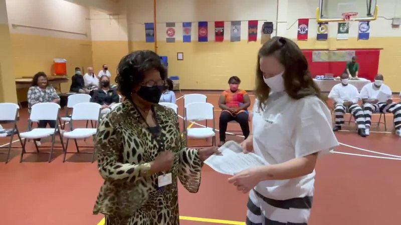 Inmates receive their diplomas