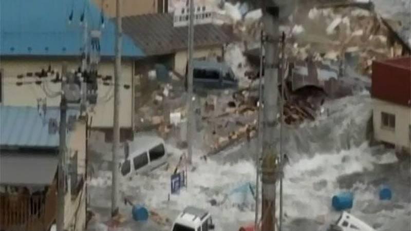 Scenes of devastation as a tsunami turned a city into a river of debris. The tsunami also...