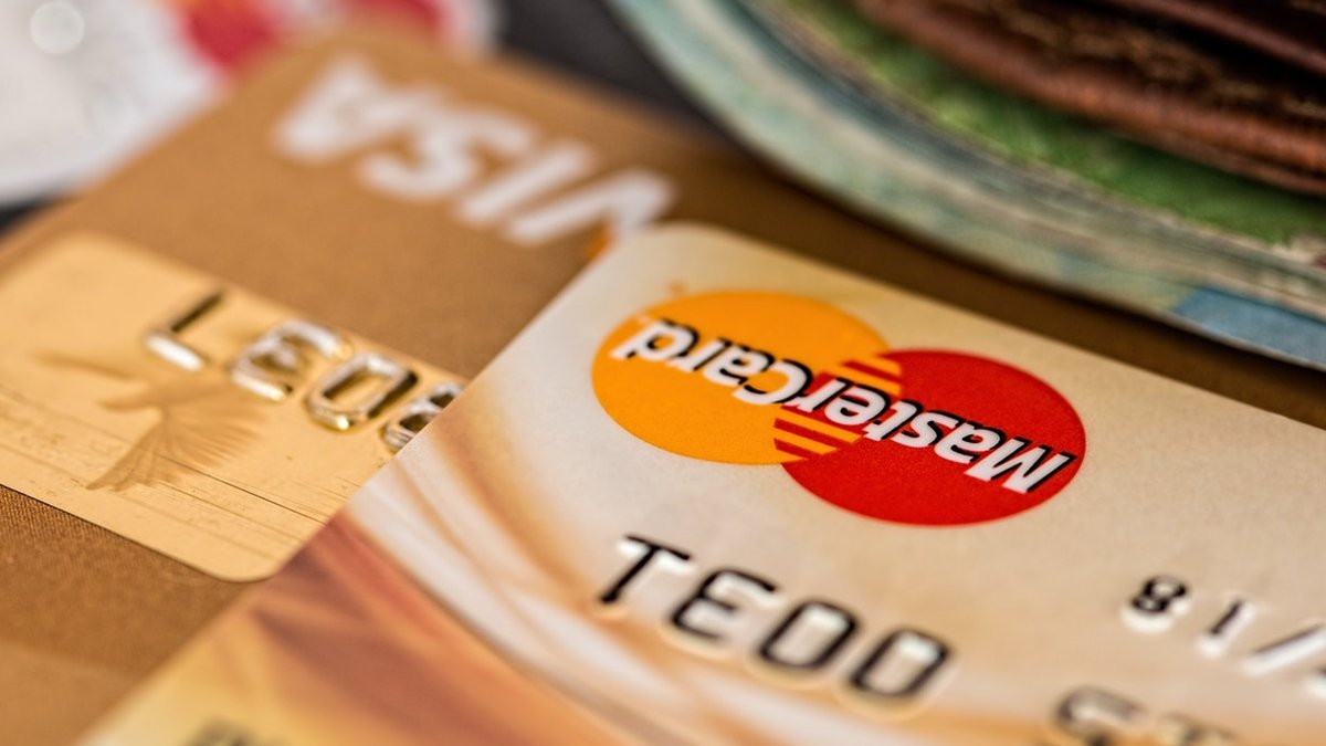 To raise your credit score, you'll need to tackle the plastic one card at a time.