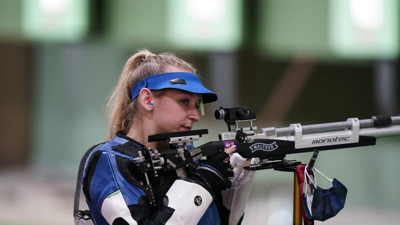 Alison Marie Weisz, of the United States, competes in the women's 10-meter air rifle at the...