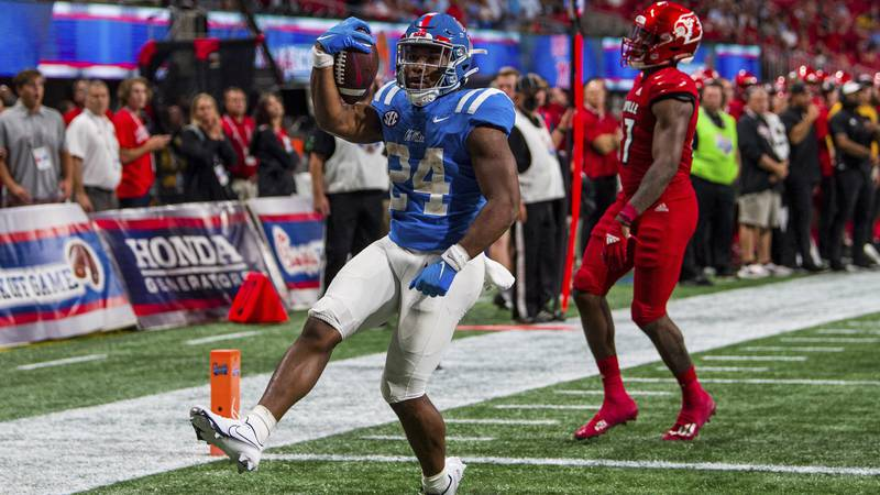 Mississippi running back Snoop Conner (24) scores a touchdown during the second half of an NCAA...