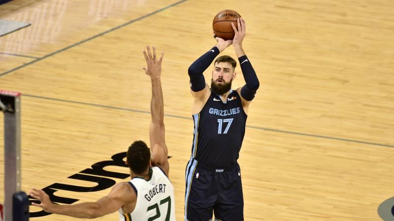 Memphis Grizzlies center Jonas Valanciunas (17) shoots against Utah Jazz center Rudy Gobert...
