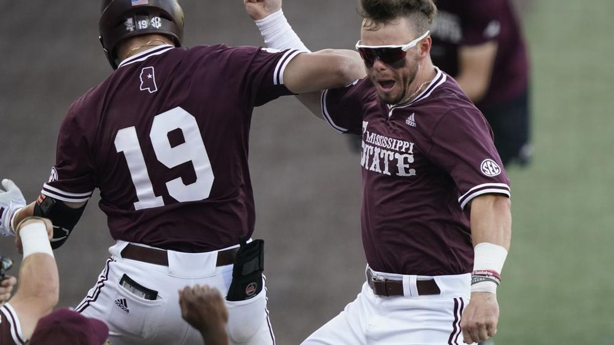 Mississippi State's Logan Tanner (19) celebrates with teammate Tanner Allen after hitting a...