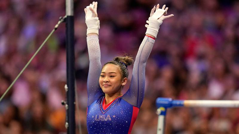 Suni Lee reacts to her performance on the uneven bars during the women's U.S. Olympic...