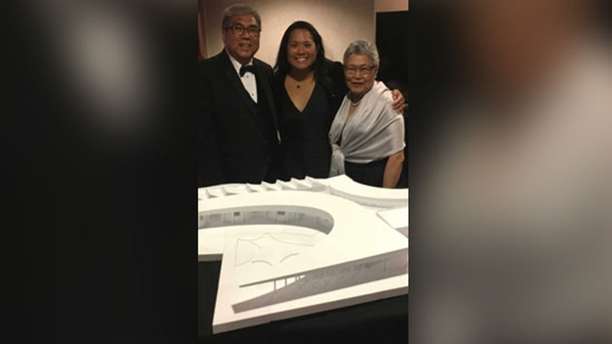 Dr. Nia Zalamea-Ducklo (Center) with her parents, Renato and Norma Zalamea standing in front of...