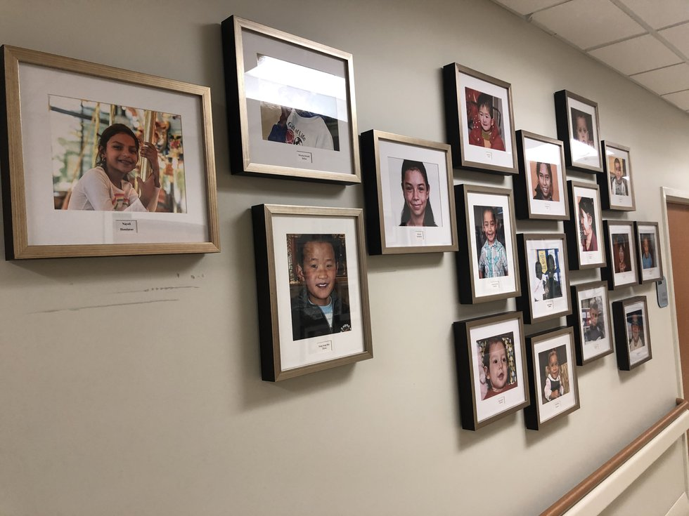 Photos of children helped by Gift of Life Mid-South line the wall at Le Bonheur Children's...
