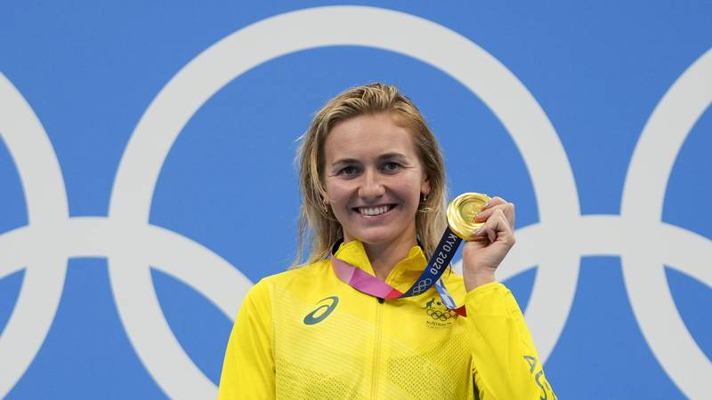 Ariarne Titmus, of Australia holds up her medal after winning the final of the women's...