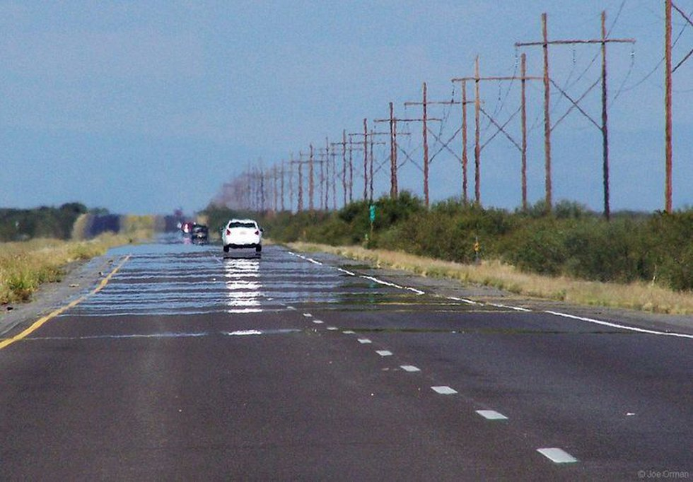 One of the most commonly seen optical illusions is the highway mirage in which shimmering pools...