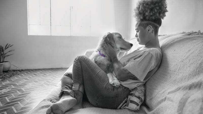 young woman with her pet dog