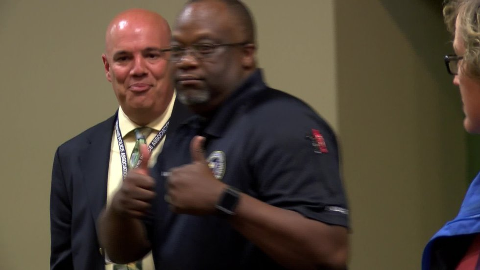 Officers Anthony Mullins and Darren Goods gave the thumbs up after the guilty verdict. (Photo...