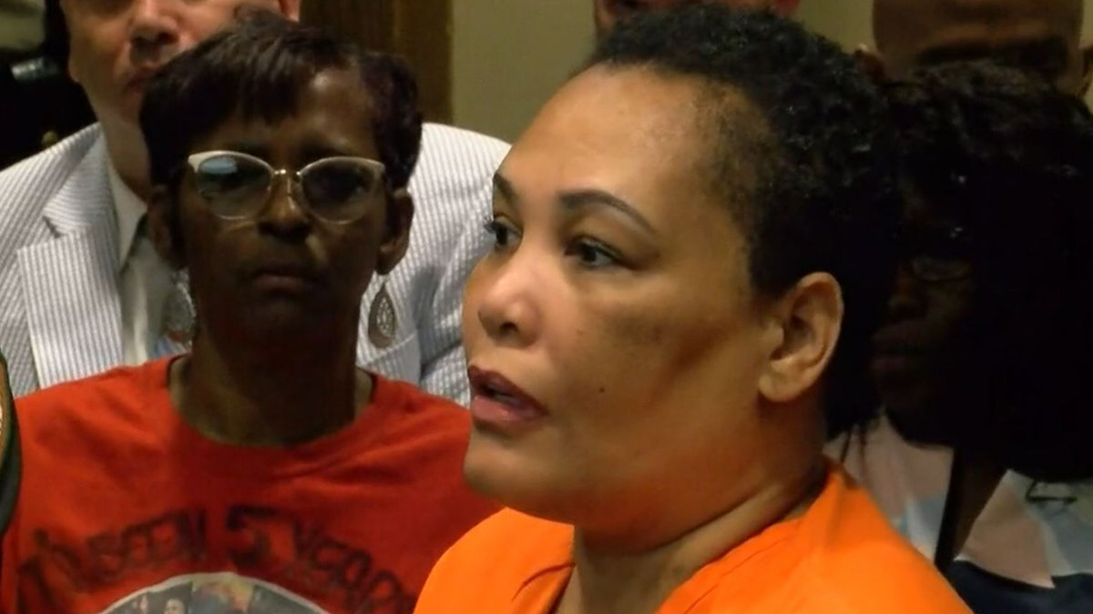 Deborah Marion, the mother of Lorenzen Wright, sits behind Sherra Wright in court July 25, 2019...