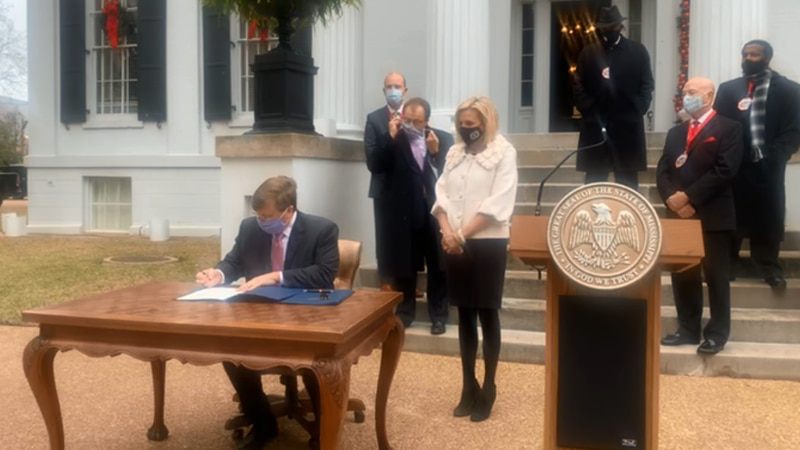 Gov. Tate Reeves signs a declaration declaring Sunday a voluntary day of prayer, humility and...