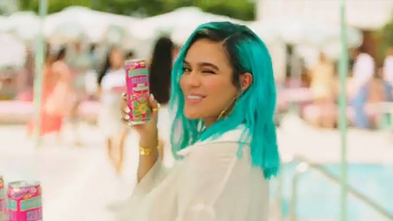 """Karol G is adding her own personal flavor and powerful voice to the Smirnoff """"For the People""""..."""
