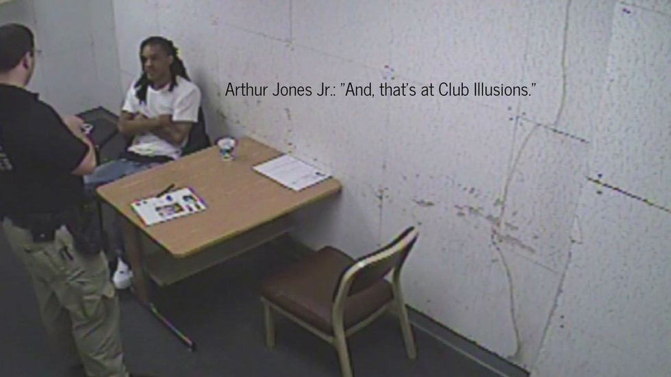 This screenshot from a video shows Arthur Jones being interrogated by police after the murder.