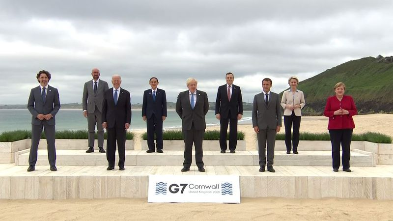 Leaders of the G7 pose for a group photo overlooking the beach in Cornwall, England, Friday,...