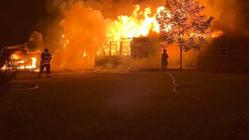 Two dozen firefighters battle house fire in Lakeland