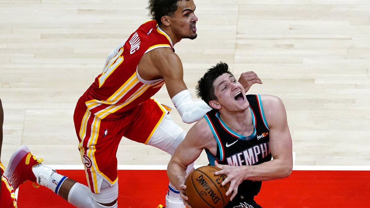 Memphis Grizzlies guard Grayson Allen (3) goes past Atlanta Hawks guard Trae Young (11) in the...