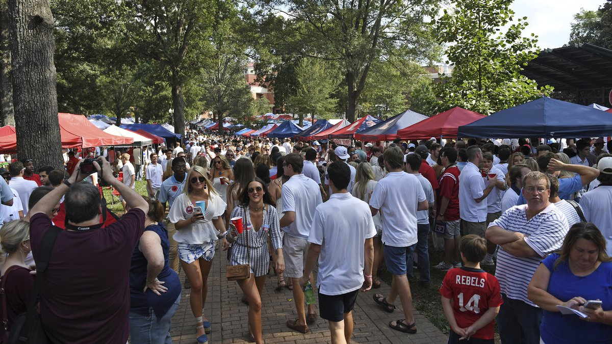 FILE - Fans tailgate in The Grove before an NCAA college football game between Mississippi and...