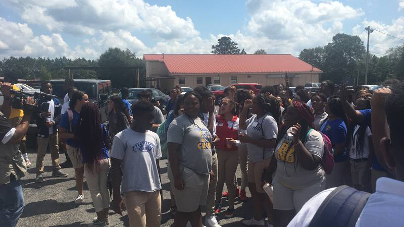 Hundreds of students chanted and gathered outside Tylertown High School protesting the end of...
