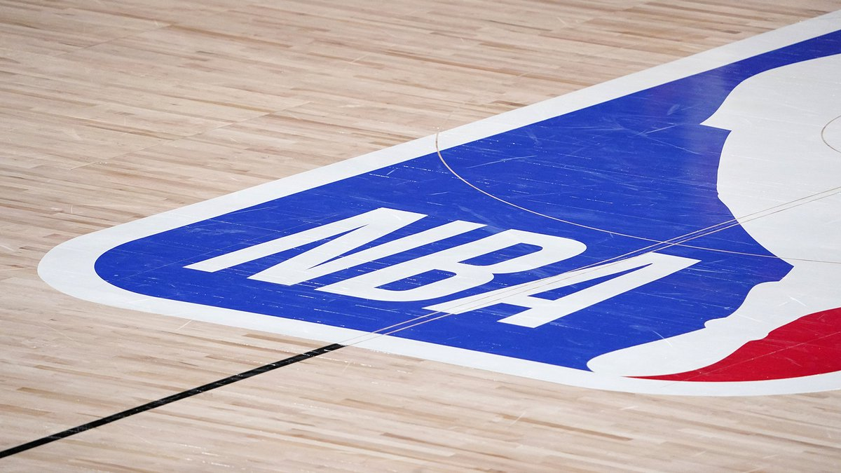 The NBA logo at center court is shown during the second half of an NBA first-round playoff...