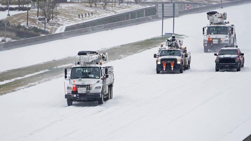 Entergy Power repair crews head north on Interstate 55 in north Jackson, Miss., Monday, Feb....