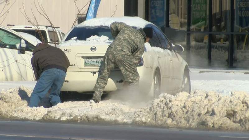Covington drivers try to get car out of snow