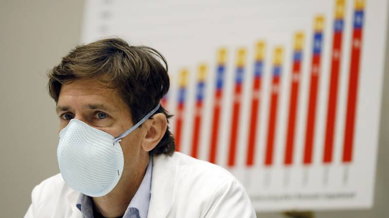 Mississippi State Health Officer Dr. Thomas Dobbs, sits before a chart showing the state's...